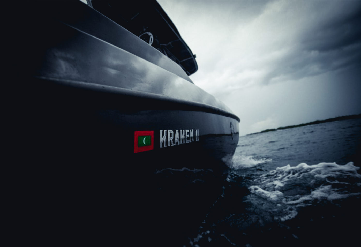 The beautiful contrast of the lettering on the black paint of the boat.